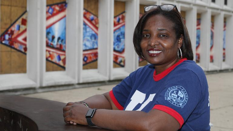 Karen Calloway, principal of Kenwood Academy in Chicago, poses Tuesday, July 28, 2020, for a portrait outside the Hyde Park neighborhood campus. (AP Photo / Charles Rex Arbogast)