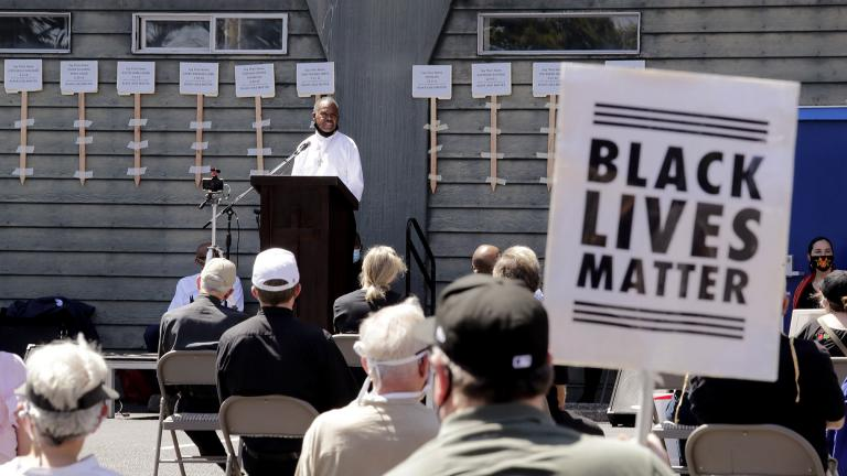 Deacon Joseph Conner speaks at an outdoor prayer vigil for racial justice at Immaculate Conception Catholic Church Sunday, July 19, 2020, in Seattle. (AP Photo / Elaine Thompson)