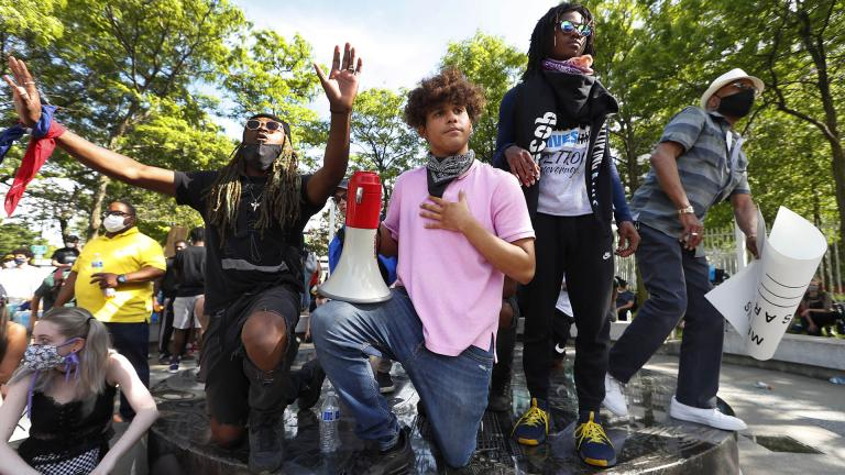 In this June 3, 2020 file photo, Stefan Perez, second from left, addresses a crowd at a rally in Detroit over the death of George Floyd. (AP Photo / Paul Sancya)