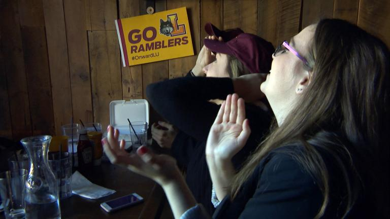 Loyola Ramblers fans cheer on the team at in Rogers Park bar Bruno's on Thursday, March 15, 2018. (WTTW News)