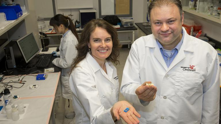 UIC bioengineering professor Ian Papautsky and Erin Haynes of the University of Cincinnati Department of Environmental Health present a sensor that will conduct rapid testing for human exposure to toxic metals. (Courtesy University of Cincinnati)