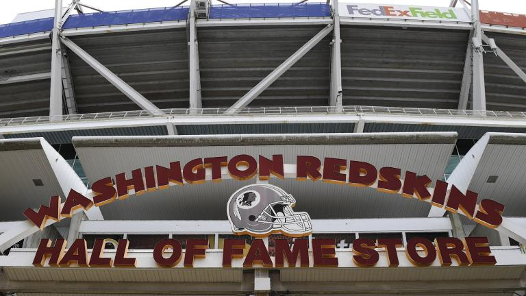 Signs for the Washington Redskins are displayed outside FedEx Field in Landover, Md., Monday, July 13, 2020. (AP Photo / Susan Walsh)