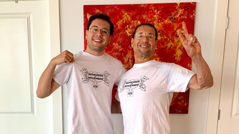 Horace Nowell III, left, and his father have their first in-person visit during the pandemic and show off their T-shirts. In the background is a painting the two made together. (Courtesy Horace Nowell)