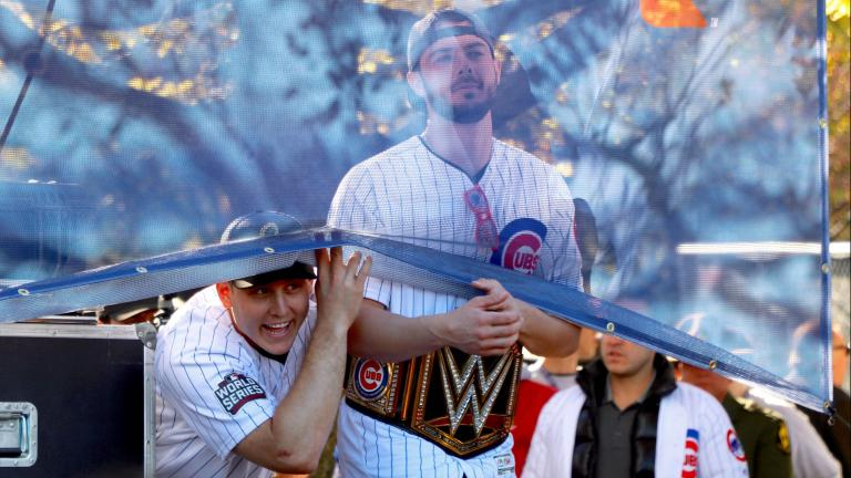 Cubs players Anthony Rizzo and Kris Bryant joke with the crowd before the team is introduced at the World Series rally in Grant Park. (Evan Garcia / Chicago Tonight)