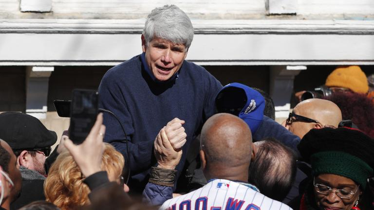 Former Illinois Gov. Rod Blagojevich acknowledges Chicago Cubs' fan Ronnie Woo Woo after a news conference outside his home Wednesday, Feb. 19, 2020, in Chicago. (AP Photo / Charles Rex Arbogast)
