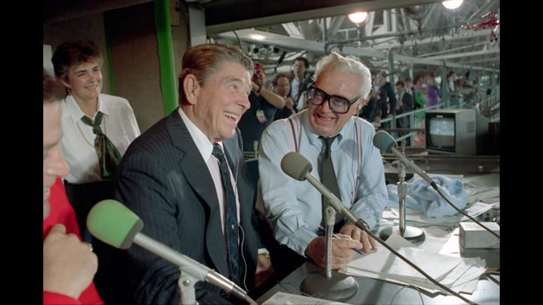 President Ronald Reagan in the press box with Harry Caray during a Chicago Cubs and Pittsburgh Pirates baseball game at Wrigley Field in Chicago on Sept. 30, 1988.