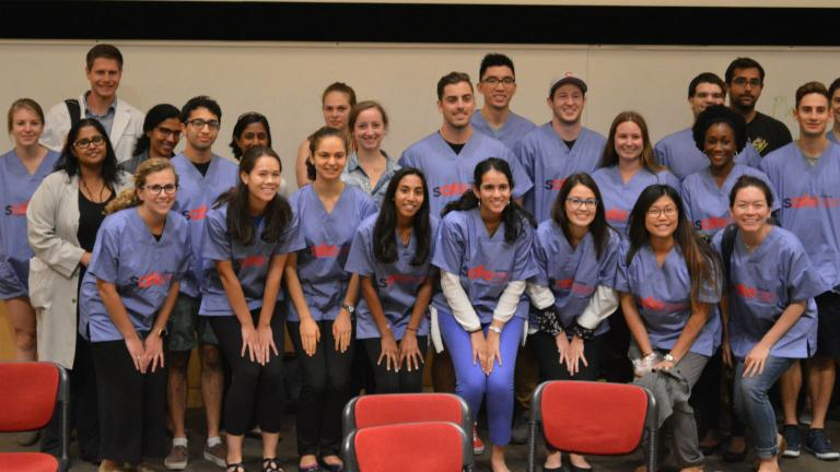 Northwestern University medical students and professors pose for a picture Monday, Sept. 17, 2018 following a panel discussion about gun violence. (Kristen Thometz / Chicago Tonight)