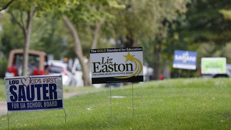 Campaign yard signs line a street Thursday, Oct. 7, 2021, in Upper Arlington, Ohio. (AP Photo / Jay LaPrete)