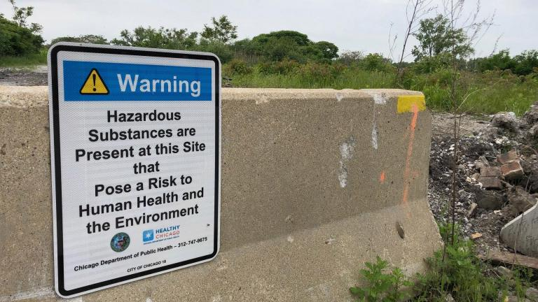 A Chicago Department of Public Health sign warns passersby about hazardous materials at a 67-acre property west of Wolf Lake at 126th Place and Avenue O. (Alex Ruppenthal / WTTW News)