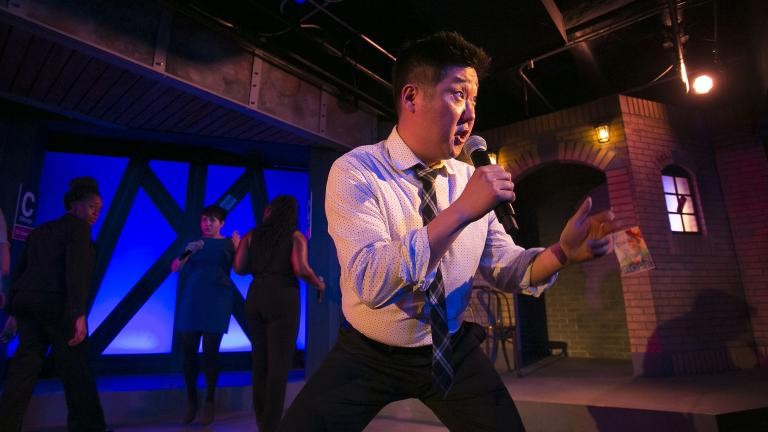 """Peter Kim performs in The Second City e.t.c.'s 40th revue, """"A Red Line Runs Through It."""" (Todd Rosenberg / The Second City)"""