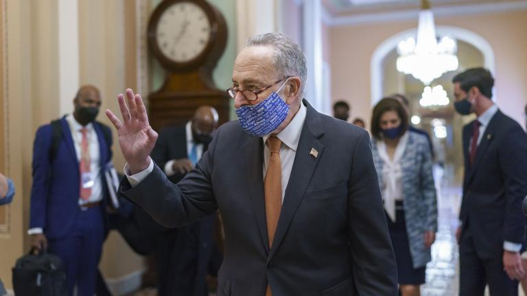 On the first full day of Democratic control, Senate Majority Leader Chuck Schumer, D-N.Y., walks to the chamber after meeting with new senators from his caucus, at the Capitol in Washington, Thursday, Jan. 21, 2021. (AP Photo/J. Scott Applewhite)