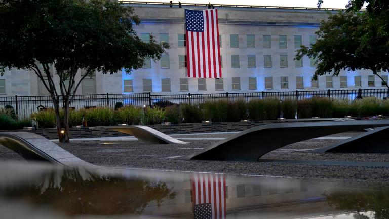 An American flag is unfurled at the Pentagon in Washington, Saturday, Sept. 11, 2021, at sunrise on the morning of the 20th anniversary of the terrorist attacks. (AP Photo / Alex Brandon)
