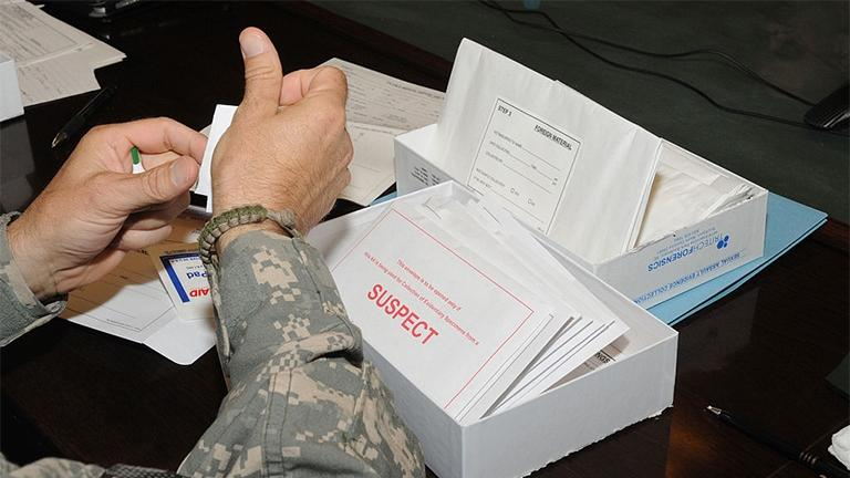 Medical professionals learn how to use the Sexual Assault Evidence Collection kit, which has several packets to collect evidence from a suspect and a patient of a sexual assault case. (Sgt. Rebecca Linder / Wikimedia Commons)