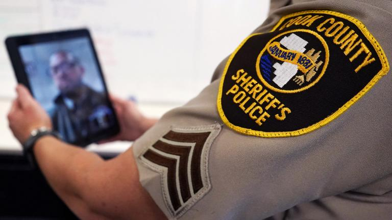 In this Friday, Aug. 13, 2021, photo Sheriff's Police Sgt. Bonnie Busching tests a virtual meeting with a tablet at the Cook County Sheriff's Office in Chicago. (AP Photo / Nam Y. Huh)