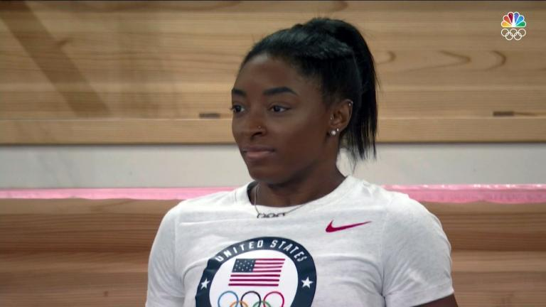 Gymnast Simone Biles cheers on her teammates at the Tokyo Olympics. (Credit: NBC)