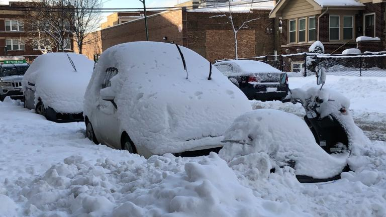 Nearly a foot of snow blanketed the Chicago region over the weekend, leaving cars covered Monday, Feb. 1. (Patty Wetli / WTTW News)