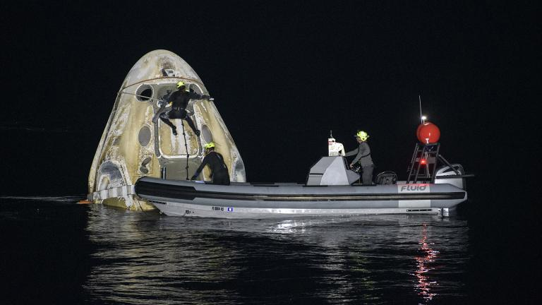Support teams work around the SpaceX Crew Dragon Resilience spacecraft shortly after it landed with NASA astronauts Mike Hopkins, Shannon Walker, and Victor Glover, and Japan Aerospace Exploration Agency (JAXA) astronaut Soichi Noguchi aboard in the Gulf of Mexico off the coast of Panama City, Florida, Sunday, May 2, 2021. (Bill Ingalls / NASA via AP)