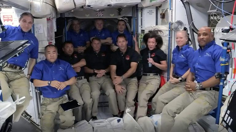 This image provided by NASA, astronauts from SpaceX join the astronauts of the International Space Station for an interview on Saturday, April 24, 2021. A recycled SpaceX capsule carrying four astronauts has arrived at the International Space Station, a day after launching from Florida. The Dragon capsule docked autonomously with the orbiting outpost on Saturday. (NASA via AP)