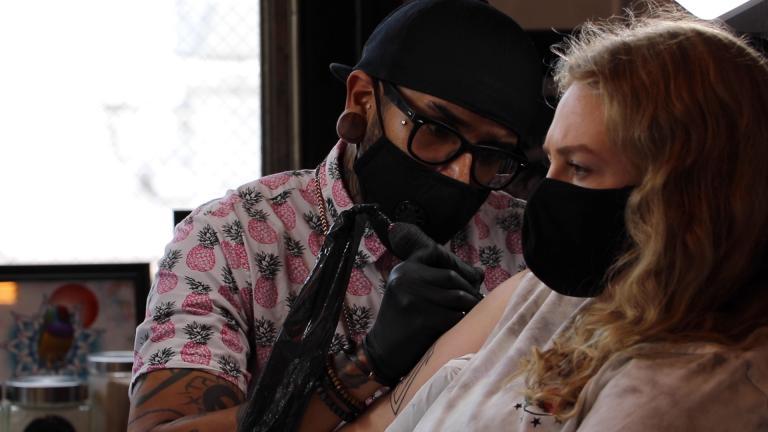 Marta Slobodyanyuk is tattooed by artist Gady Mercado at Speakeasy Custom Tattoos in Chicago's Wicker Park neighborhood on June 22, 2020. (Evan Garcia / WTTW News)