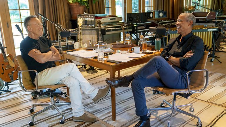 Bruce Springsteen, left, appears with former President Barack Obama during their podcast of conversations recorded at Springsteen's home studio in New Jersey. The eight-episode series covers their upbringings, racism, fatherhood and even recall a White House singalong around a piano. (Rob DeMartin / Spotify via AP)