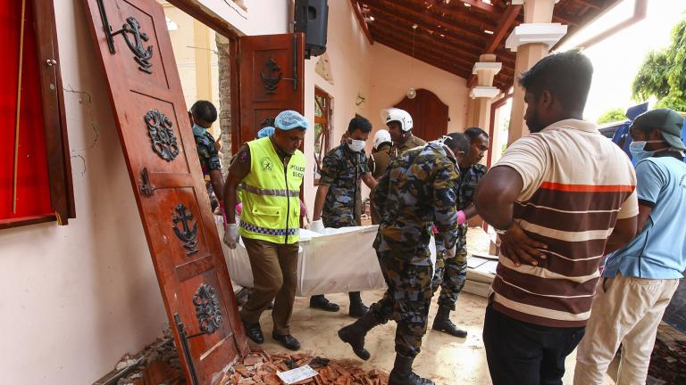 Sri Lankans carry a dead body at St. Sebastian's Church damaged in a blast in Negombo, north of Colombo, Sri Lanka, Sunday, April 21, 2019. (AP Photo / Chamila Karunarathne)