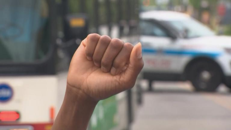 A demonstrator raises a fist during a peace rally organized by St. Sabina Church on June 4, 2020 in Chicago. (WTTW News)