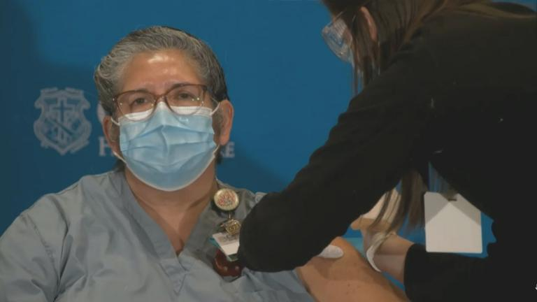 A health care worker gets the COVID-19 vaccine in Peoria, Illinois on Tuesday, Dec. 15, 2020. (WTTW News)
