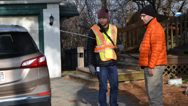 John Berg, an environmental health specialist with the DuPage County Health Department, runs water from a private well in Willowbrook on Thursday as part of testing for levels of cancer-causing ethylene oxide. (Alex Ruppenthal / WTTW)