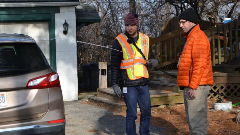 John Berg, an environmental health specialist with the DuPage County Health Department, runs water from a private well in Willowbrook on Dec. 13, 2018, as part of testing for levels of cancer-causing ethylene oxide. (Alex Ruppenthal / WTTW)