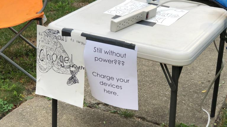 Neighbors with power have set up charging stations for those without in the Lincoln Square community. (Patty Wetli / WTTW News)