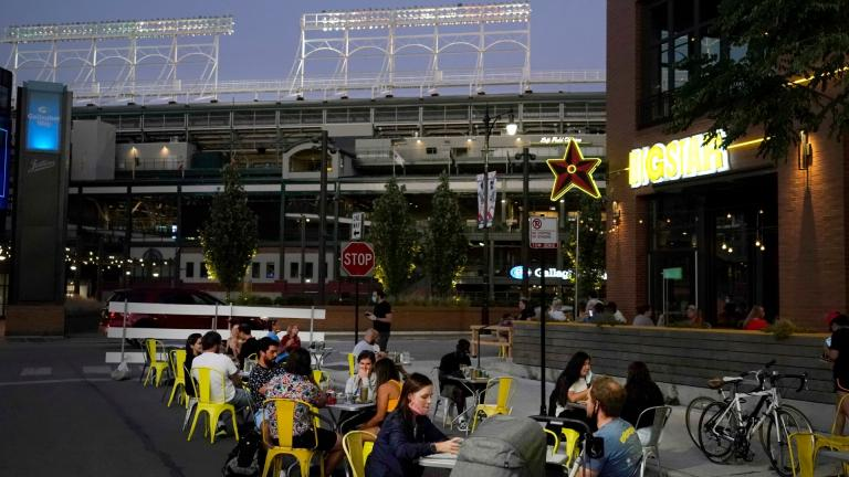 Patrons at the Big Star Wrigleyville restaurant Friday, Sept. 4, 2020, are seated in a social distant manner on West Patterson Ave., across from Wrigley Field during a baseball game between the Cubs and St Louis Cardinals in Chicago. (AP Photo / Charles Rex Arbogast)