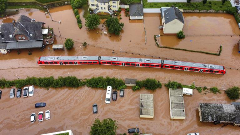 In this Thursday, July 15, 2021, 2021 file photo, a regional train in the flood waters at the local station in Kordel, Germany, after it was flooded by the high waters of the Kyll river. (Sebastian Schmitt / dpa via AP, File)