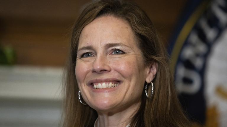 In this Oct. 1, 2020, photo, Supreme Court nominee Judge Amy Coney Barrett meets with Sen. Roger Wicker, R-Miss., at the Capitol in Washington. (Graeme Jennings / Pool via AP)