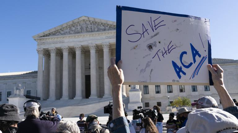 A demonstrator holds a sign in front of the U.S. Supreme Court as arguments are heard about the Affordable Care Act, Tuesday, Nov. 10, 2020, in Washington. (AP Photo / Alex Brandon)