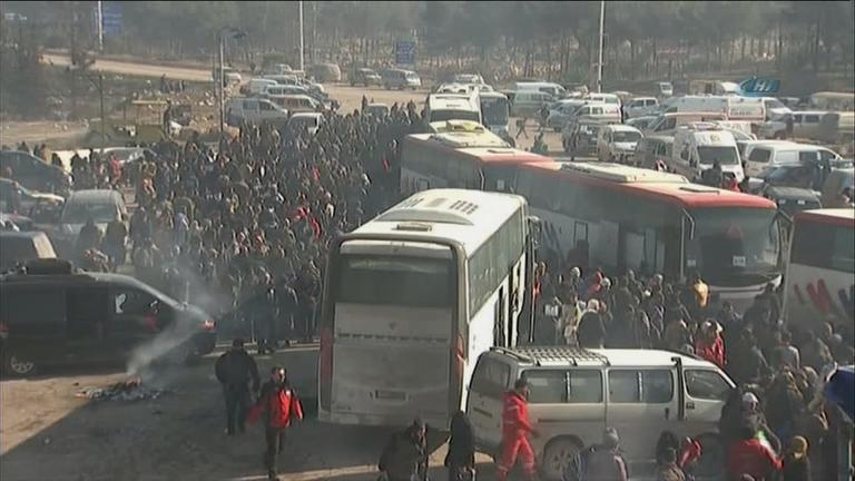 Refugees stream out of Aleppo, Syria. (Courtesy of CNN)