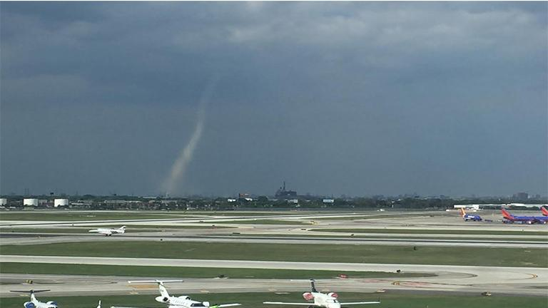 A landspout can be seen off in the distance Tuesday just outside Midway Airport. The brief tornado was Chicago's first since 2006. (Courtesy of Melanie Harnacke)