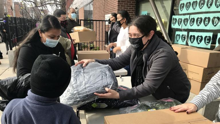 Families pick up Thanksgiving meal boxes and coats for their children at West Town nonprofit Northwestern Settlement on Saturday, Nov. 21, 2020. (Ariel Parrella-Aureli / WTTW News)