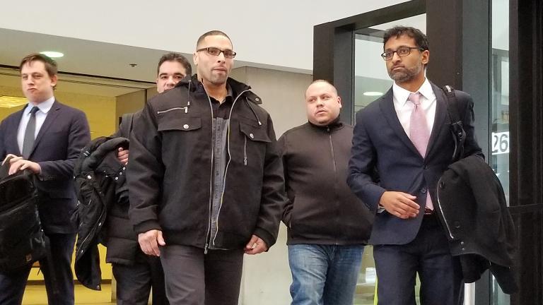 Thomas Sierra, center, exits the George N. Leighton Criminal Courthouse on Tuesday. (Matt Masterson / Chicago Tonight)