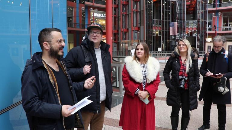 Jonathon Solomon, left, of the James R. Thompson Center Historical Society introduces his group at the start of their public tour. (Evan Garcia / WTTW News)