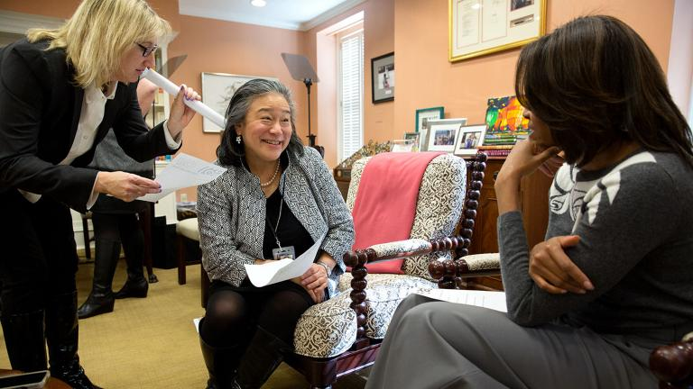 Tina Tchen, center, speaks with Michelle Obama. (Pete Souza / The White House)