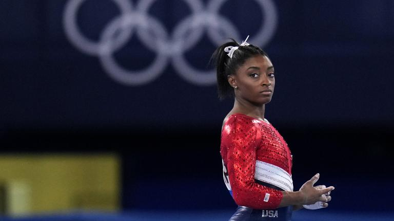 Simone Biles, of the United States, waits to perform on the vault during the artistic gymnastics women's final at the 2020 Summer Olympics, Tuesday, July 27, 2021, in Tokyo. The American gymnastics superstar has withdrawn the all-around competition to focus on her mental well-being. (AP Photo / Gregory Bull)
