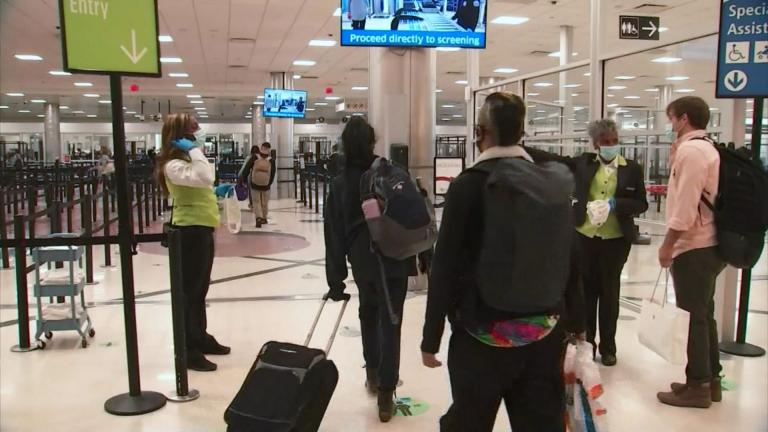 Public health officials have been urging Americans to reconsider their travel plans this holiday week amid a resurgence of COVID-19 infections. (WTTW News via CNN)
