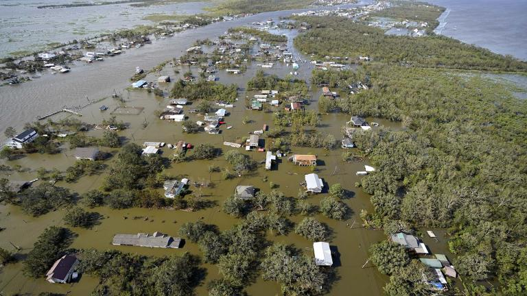 Homes are flooded in the aftermath of Hurricane Ida, Monday, Aug. 30, 2021, in Lafitte, La. The weather died down shortly before dawn. (AP Photo / David J. Phillip)