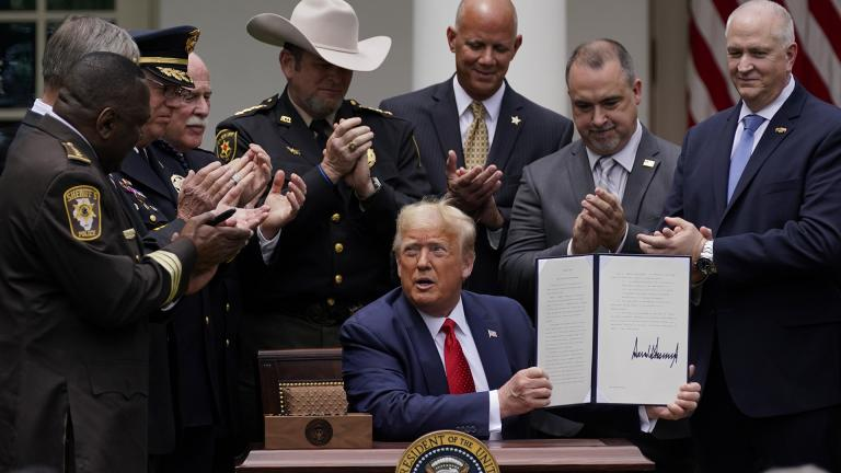 Law enforcement officials applaud after President Donald Trump signed an executive order on police reform, in the Rose Garden of the White House, Tuesday, June 16, 2020, in Washington. (AP Photo / Evan Vucci)