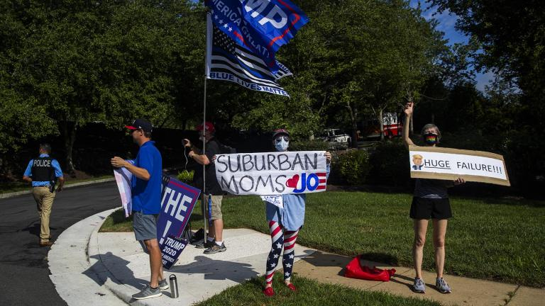 Protesters and supporters of President Donald Trump wave banners as the president's motorcade enters the Trump National Golf Club in Sterling, Va., Sunday, Aug. 23, 2020. (AP Photo / Manuel Balce Ceneta)