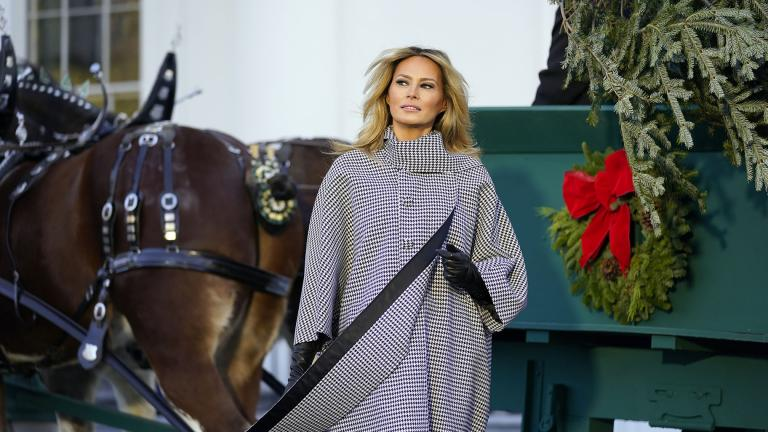 First lady Melania Trump stands next to the 2020 Official White House Christmas tree as it is presented on the North Portico of the White House, Monday, Nov. 23, 2020, in Washington. (AP Photo / Andrew Harnik)