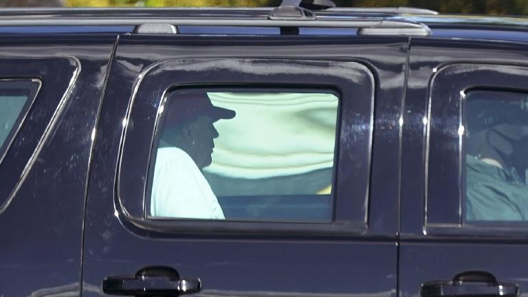 President Donald Trump rides in a motorcade vehicle as he departs Trump International Golf Club, Sunday, Dec. 27, 2020, in West Palm Beach, Fla. (AP Photo / Patrick Semansky)