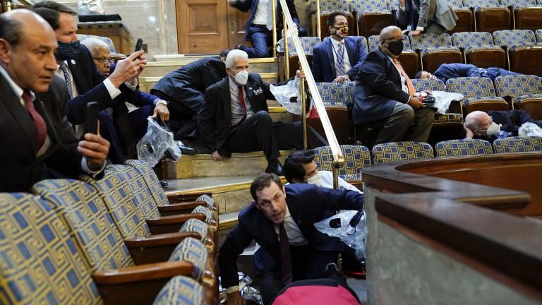 In this Jan. 6, 2021, file photo people shelter in the House gallery as rioters try to break into the House Chamber at the U.S. Capitol. (AP Photo / Andrew Harnik, File)