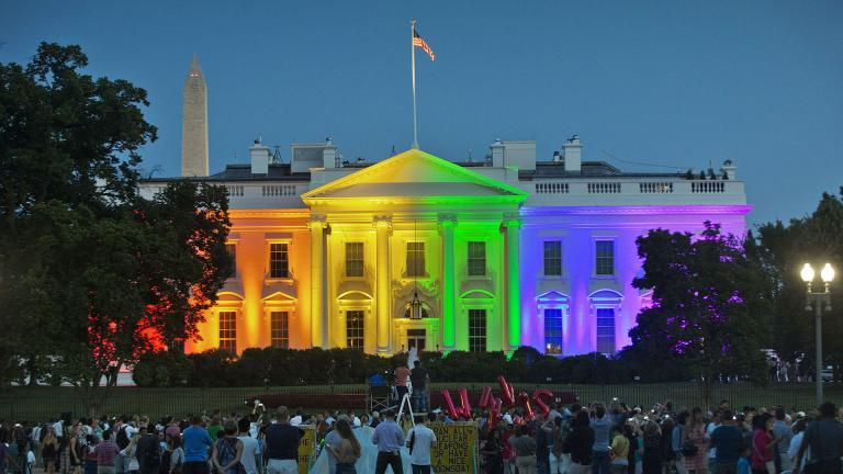 In this Friday, June 26, 2015 file photo, people gather in Lafayette Park to see the White House illuminated with rainbow colors in commemoration of the Supreme Court's ruling to legalize same-sex marriage in Washington. The Trump administration Friday, June 12, 2020, finalized a regulation that overturns Obama-era protections for transgender people against sex discrimination in health care. (AP Photo/Pablo Martinez Monsivais, File)
