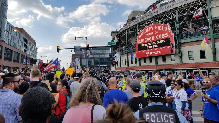 Protesters arrive at Wrigley Field. (Matt Masterson / Chicago Tonight)
